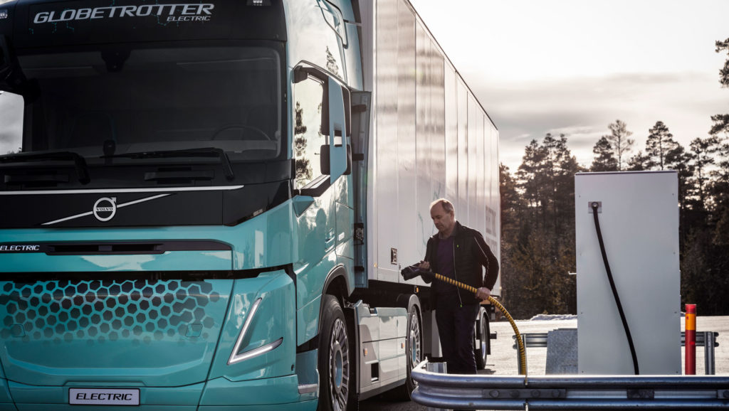 Image of driver charging a Volvo electric concept truck.