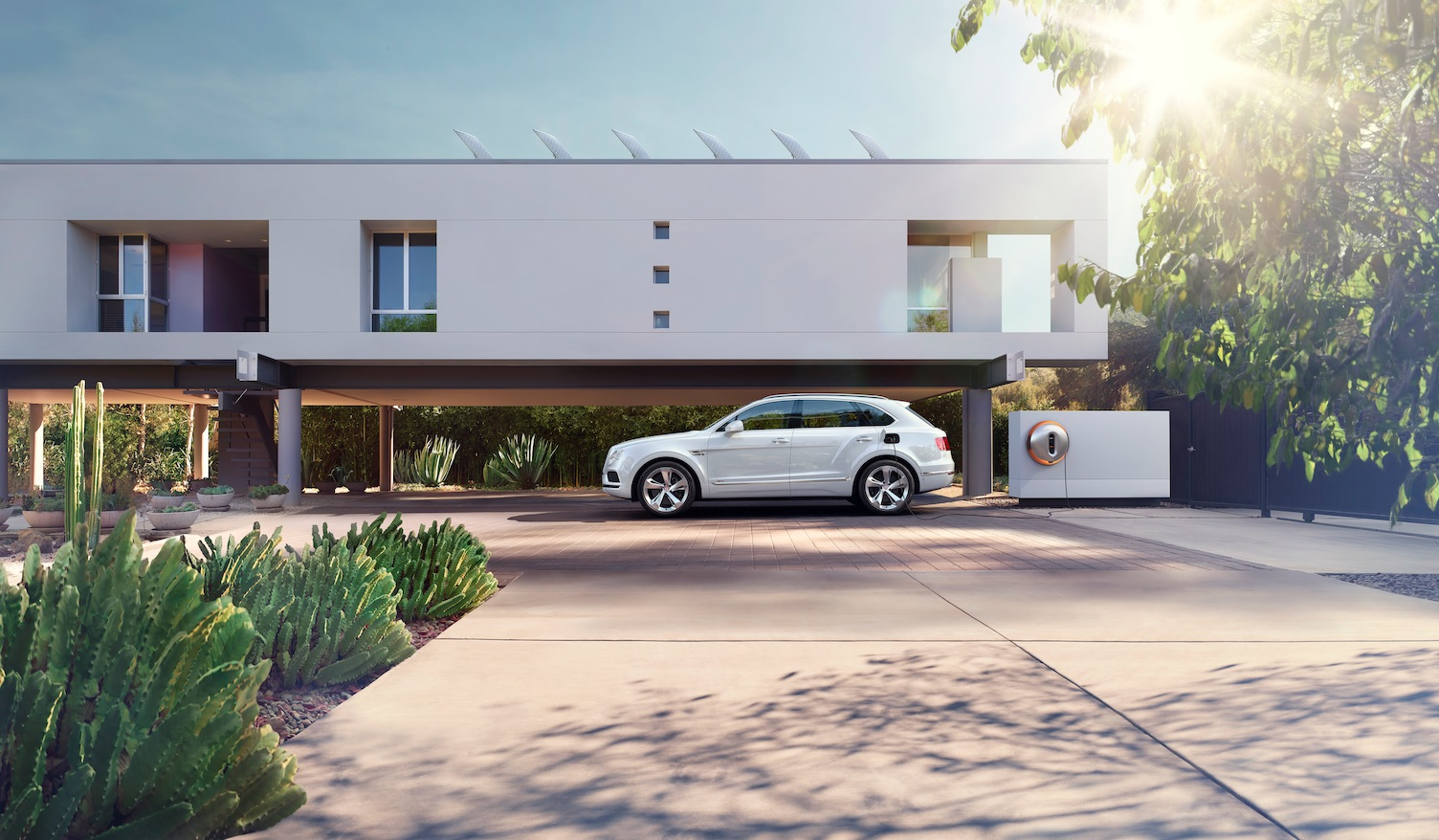 Photo of Bentley Bentayga Plug-In Hybrid with home charging station concept by Philipe Starck.