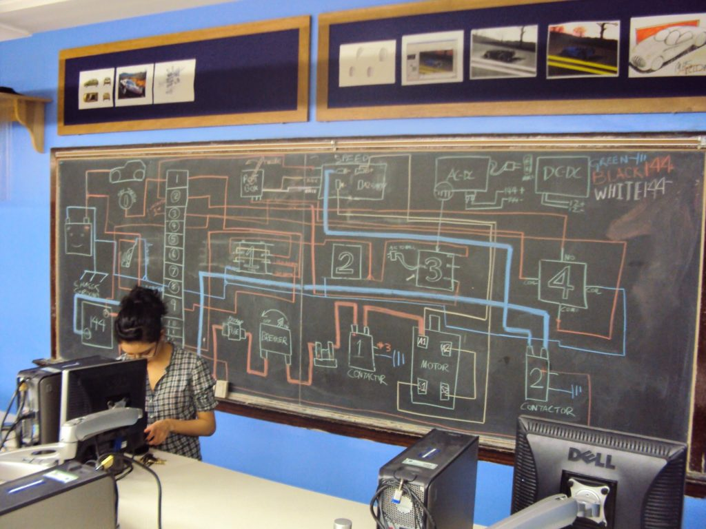 Photo of chalk board containing electrical engineering drawings.